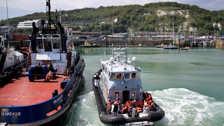 A group of people thought to be migrants are brought in to Dover, Kent, following a small boat incident in the Channel earlier this morning. Picture date: Sunday June 6, 2021.