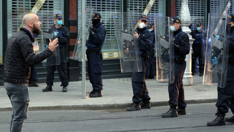 05/06/2021 Covid-19 Pandemic (Coronavirus), Ireland. Day 436 since start of lockdown. Day 26 of eased restrictions. Pictured a man pleading with members of the An Garda Siochana Public Order unit wearing riot gear and shields on Dawson Street in Dublin city this evening. Photo: Sam Boal/Rollingnews.ie