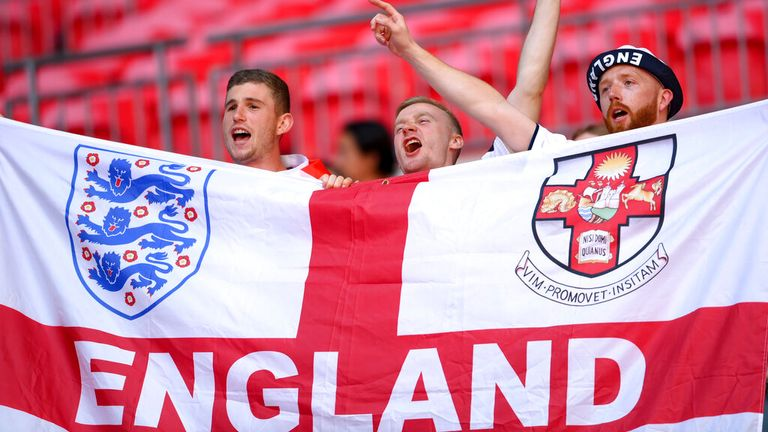 Fans cheer from the stands at Wembley. Pic: AP