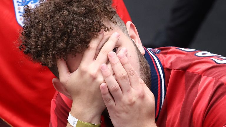 An England fan can barely watch in the first half, as England and Germany draw blanks in the first half