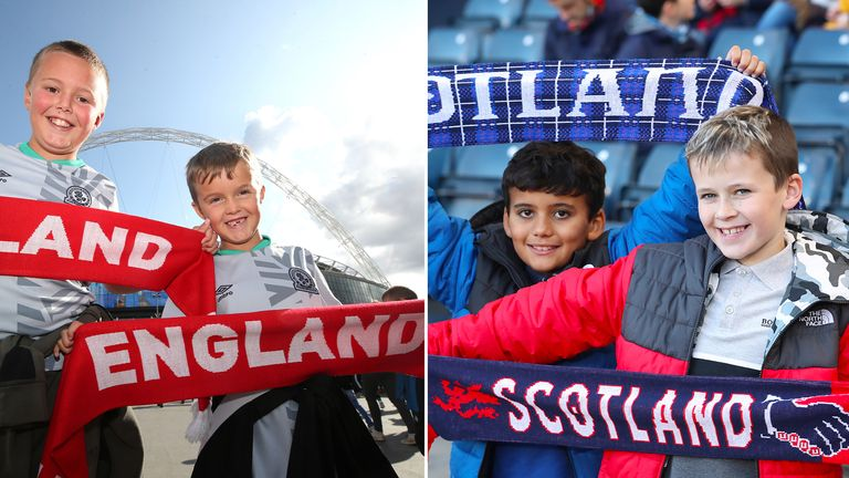 Young England fans pose with a scarf outside the stadium prior to the Euro 2020 Qualifying Group A match at Wembley Stadium, London.