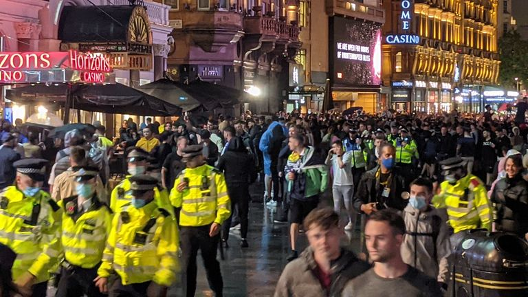 Crowds gathered in Leicester Square late into the night after the Euro 2020 tie. Credit Rene Wolter
