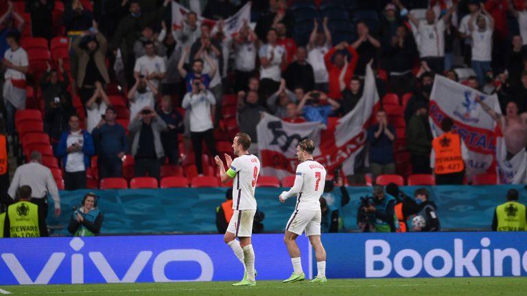 England's Harry Kane celebrates with Jack Grealish after the match