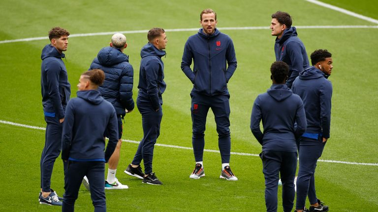 The England players take to the Wembley pitch before kick off