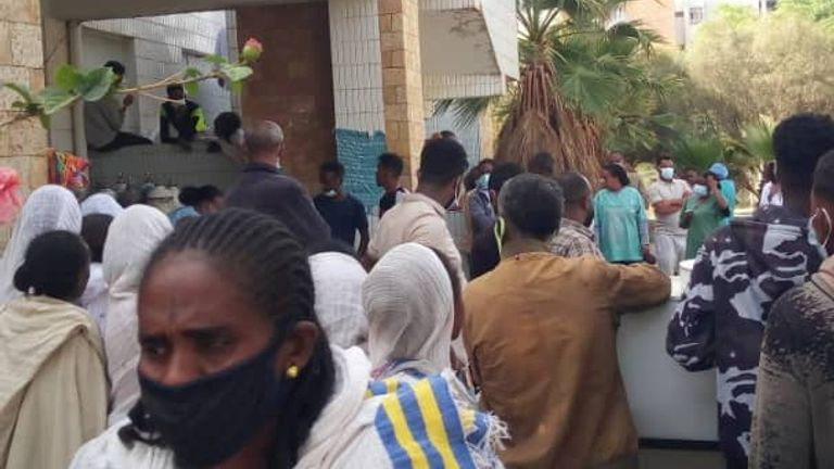 People gather as victims arrive at Ayder Referral Hospital, in Mekelle, after an airstrike in Togoga, Ethiopia's Tigray region