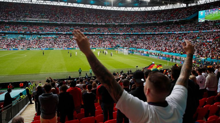 Soccer Football - Euro 2020 - Round of 16 - England v Germany - Wembley Stadium, London, Britain - June 29, 2021 England fan celebrates during the match Pool via REUTERS/Matthew Childs