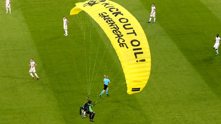A protester lands in the stadium prior to the Euro 2020 group F match between France and Germany at the Allianz Arena stadium in Munich
