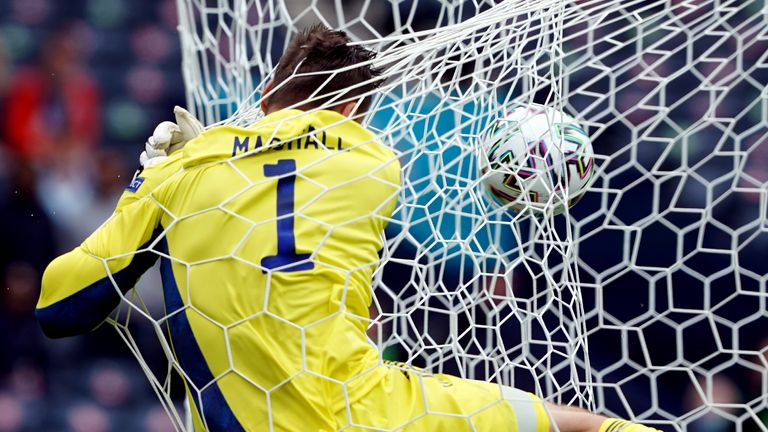 Scotland goalkeeper David Marshall crashes into the back of the net after conceding the second goal scored by Czech Republic's Patrik Schick (out of pic) during the UEFA Euro 2020 Group D match at Hampden Park, Glasgow. Picture date: Monday June 14, 2021.
