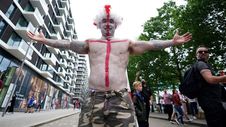 An England fan shows off a St George's Cross painted on his body