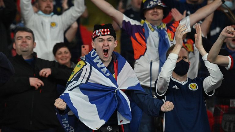 Scotland fans celebrate after the 0-0 draw with England