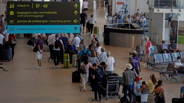 People wait in queues at Faro airport amid the coronavirus disease (COVID-19) pandemic, in Faro, Portugal, June 6, 2021. REUTERS/Pedro Nunes