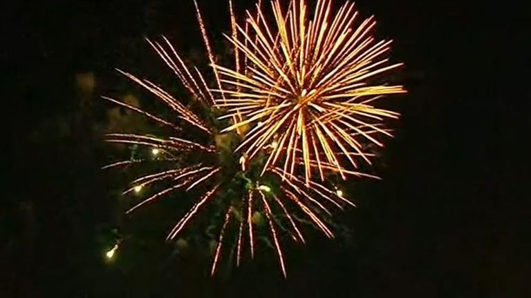 Fireworks launched in New York to mark 70% of adult population receiving one COVID jab