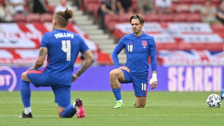 England's Jack Grealish takes a knee. Pic: AP