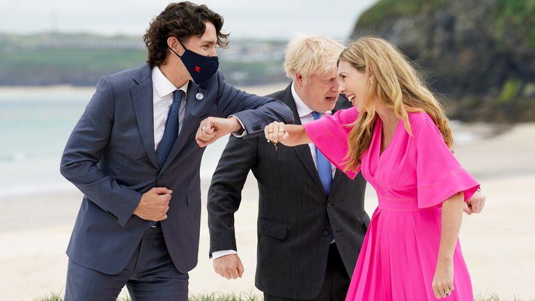 Canada's Prime Minister Justin Trudeau bumps elbows with Britain's Prime Minister Boris Johnson's spouse Carrie Johnson, next to Britain's Prime Minister Boris Johnson, during the G7 summit in Carbis Bay, Cornwall, Britain, June 11, 2021. REUTERS/Kevin Lamarque/Pool