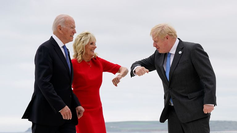 U.S. President Joe Biden and first lady Jill Biden are greeted by British Prime Minister Boris Johnson before posing for photos at the G-7 summit, in Carbis Bay, Britain, June 11, 2021. Patrick Semansky/Pool via REUTERS