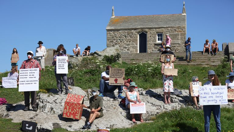 No Going Back Sundays activists hold placards as they take part in a demonstration for racial, climate, social and nature justice, at the Island in St Ives, during the G7 summit in Cornwall