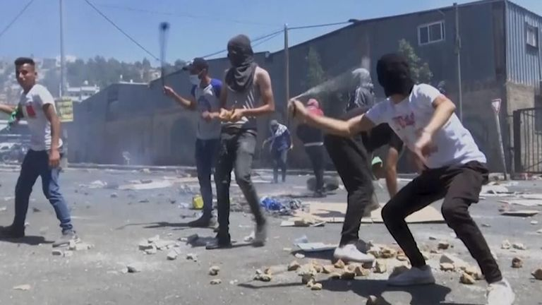 Dozens of Palestinians clashed with the Israeli army in the village of Beita on Friday to protest against a settlement outpost.