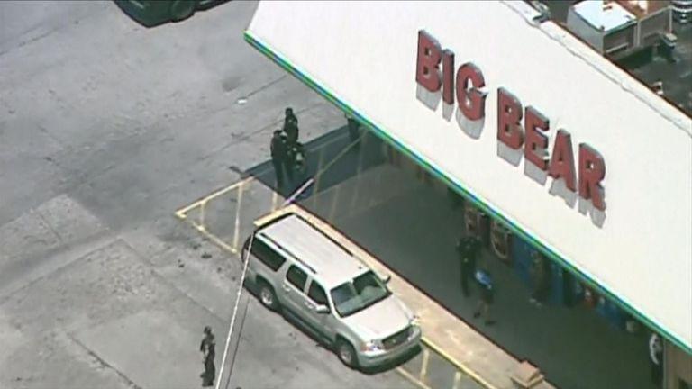 Officers outside the Big Bear Supermarket in DeKalb County, Georgia