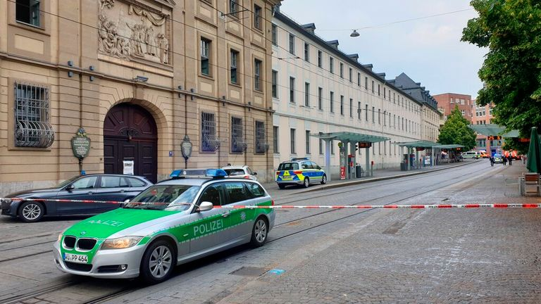 Police at the scene of the incident in Wuerzburg, Germany Pic: AP