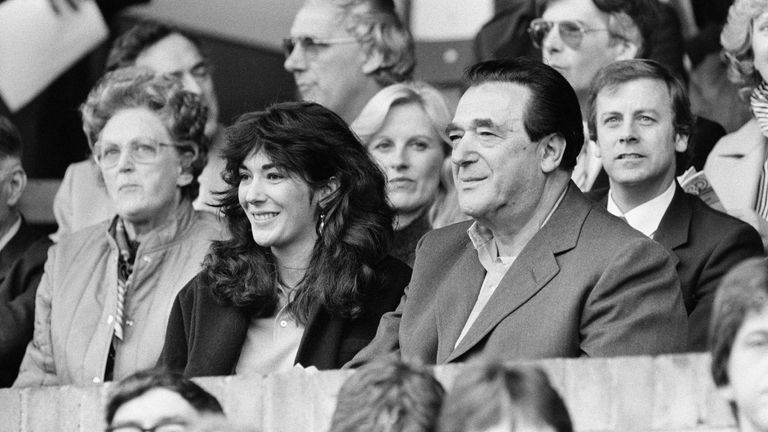 Robert Maxwell and his daughter Ghislaine watch the Oxford v Brighton football match in October 1984. Pic: Mirrorpix/Sky UK