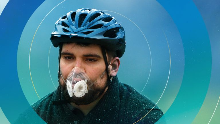 A cyclist wears a mask with an air filter as he cycles through Hyde Park in London April 3, 2014. A dust cloud from the Sahara has covered south east England, raising pollution levels to the highest level in London, preventing people taking exercise outdoors, including the Prime Minister, David Cameron, who said he had skipped his morning jog.