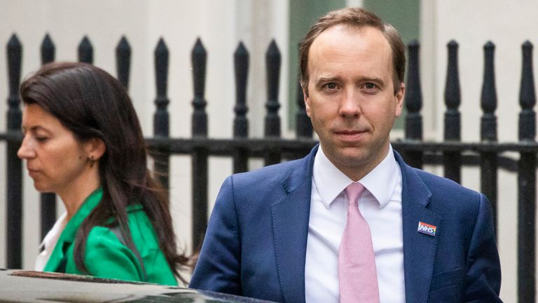Matt Hancock leaves 10 Downing Street with his assistant Gina Coladangelo in May