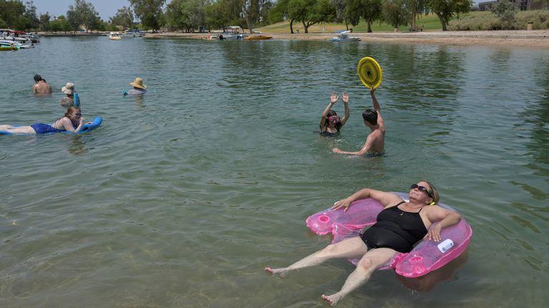 People cool off in the water in Lake Havasu, Arizona