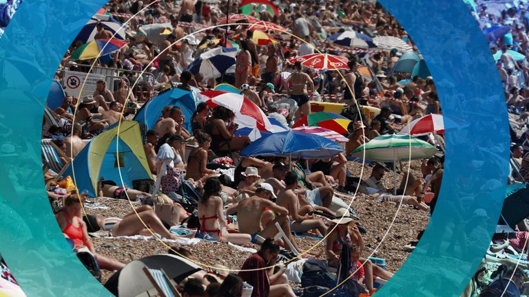 Beachgoers enjoy the sunshine and sea on what is now Britain's hottest day of the year so far, in Brighton, England, Friday, July 31, 2020. Temperatures have reached 35C (95F) at London's Heathrow Airport.