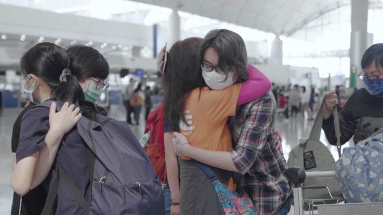 The family's friends came to hug them goodbye as they left Hong Kong