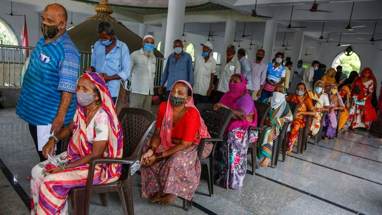 People line up for a vaccine in Ahmedabad - but India has jabbed only  17% of people