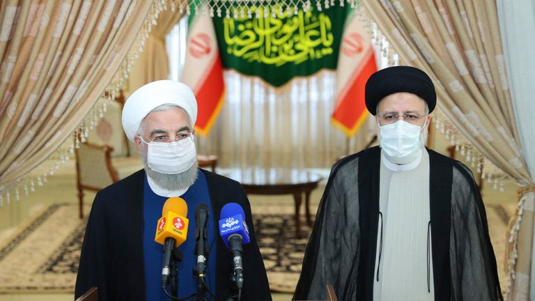 In this photo released by the official website of the office of the Iranian Presidency, President Hassan Rouhani (left), speaks with the media after his meeting with Ebrahim Raisi. Pic AP