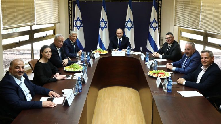 Party leaders of the new coalition government posed for a picture at the Knesset, Israel's parliament, before the start of a special session to approve and swear-in the coalition government, in Jerusalem