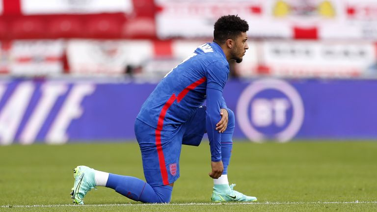 England's Jadon Sancho takes a knee before during the international friendly match at Riverside Stadium, Middlesbrough on Sunday June 6, 2021
