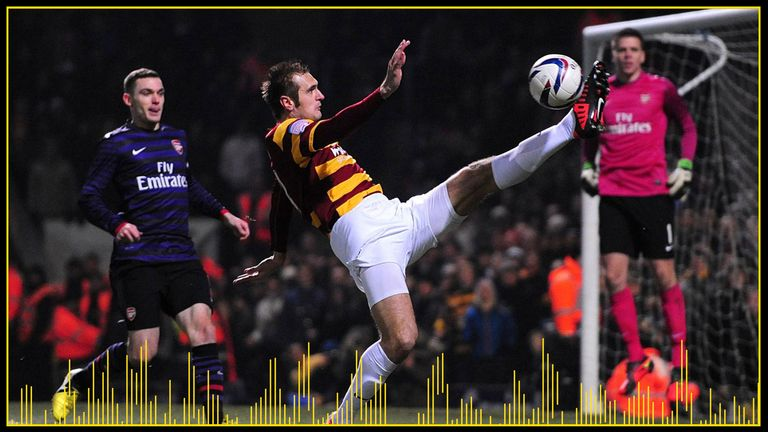 Hanson attempts to control the ball near Arsenal's goal during the League Cup clash in 2012