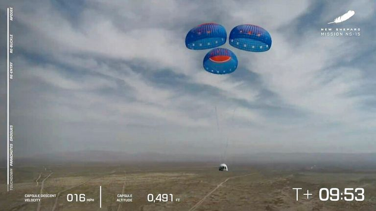 The New Shepard capsule is seen using parachutes to land during a test in Texas in April. Pic: AP