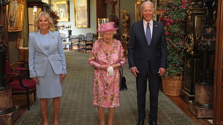 The Queen with Joe Biden and Dr Jill Biden in the Grand Corridor of Windsor Castle