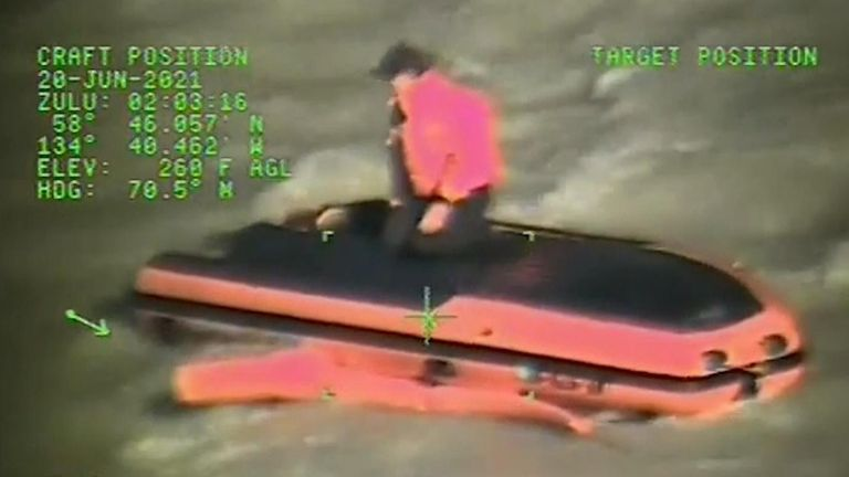 The crew of the MI-1-60 Jayhawk helicopter hoisted one person from the overturned boat and the other from the shore.