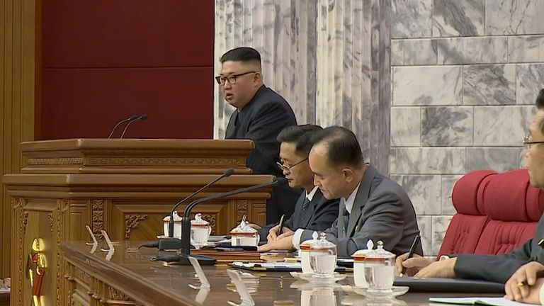 North Korean Leader Kim Jong Un speaks at a meeting of the Workers' Party of Korea in this still image taken from KRT footage on 16 June