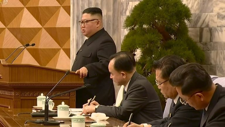 Kim Jong Un speaks at a meeting of the Workers' Party in this still image taken from KRT footage on 12 February 2021