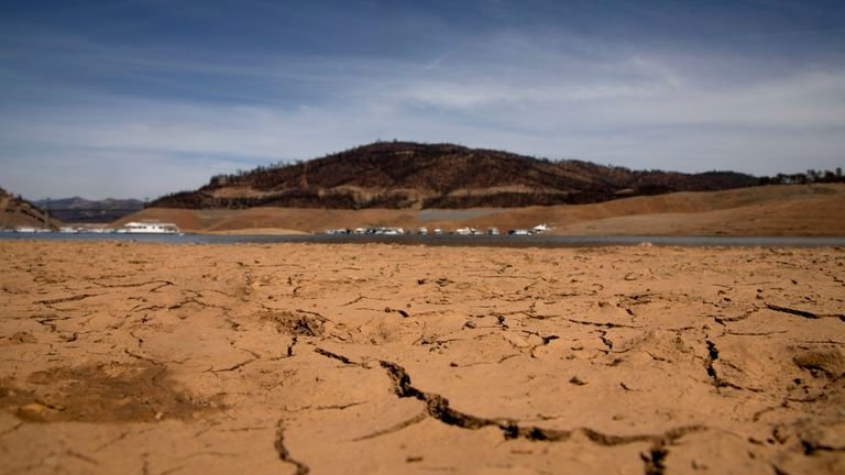 Dry land is visible, at a section that is normally under water, on the banks of Lake Oroville