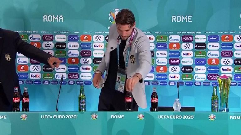 Italy's Manuel Locatelli became the latest player to move a branded drink ahead of a news conference at Euro 2020 on Wednesday (June 16).  Locatelli moved two Coca-Cola bottles to the side and placed a bottle of water in front of him.