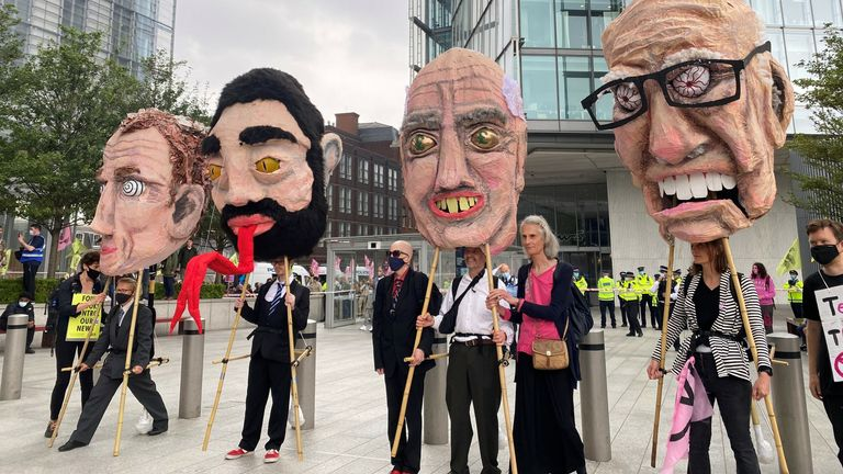 Huge papier-mâché heads were held up of Lord Rothermere, Baron Evegeny Lebedev, Sir Frederick Barclay and Rupert Murdoch