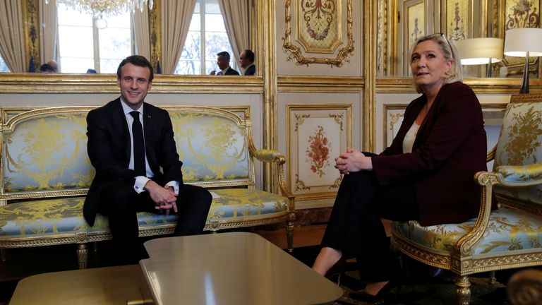 Macron pictured here meeting with Marine Le Pen in 2019. Ms Le Pen party is projected to win at least one region for the first time