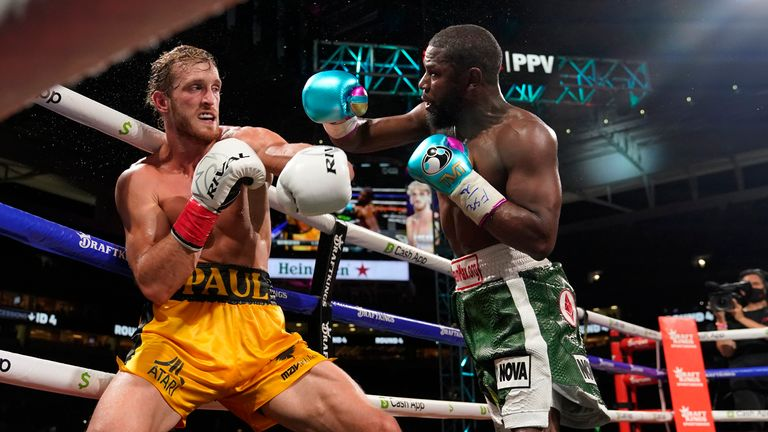 Floyd Mayweather, right, throws a punch at Logan Paul, left, during an exhibition boxing match at Hard Rock Stadium, Sunday, June 6, 2021. Pic: AP