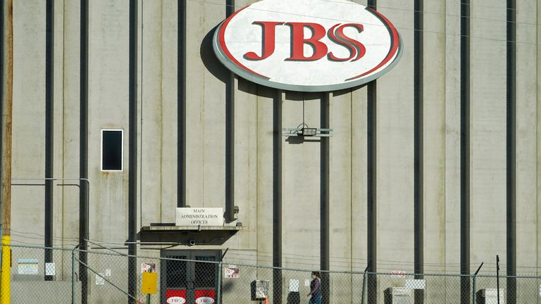 Hold For Release on Friday, Oct. 30, With Patty Nieberg Story slugged Virus Outbreak Lives Lost Meat Plant...A worker heads into the JBS meat packing plant Monday, Oct. 12, 2020, in Greeley, Colo. (AP Photo/David Zalubowski)...