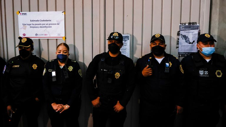 Police officers stand in front of a polling station after polls closed on mid-term election day in Mexico City, Mexico, June 6, 2021. REUTERS/Carlos Jasso