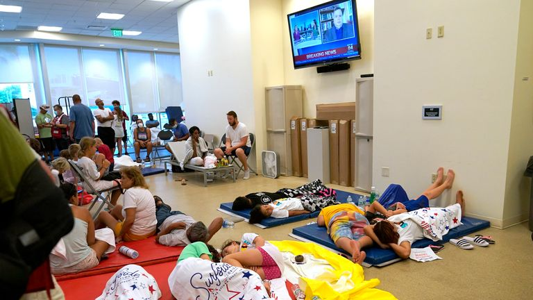 People wait for news at a family reunification centre in Miami. Pic: AP