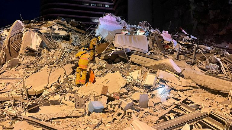 Mattresses can be seen among the rubber after the collapse of the apartment block