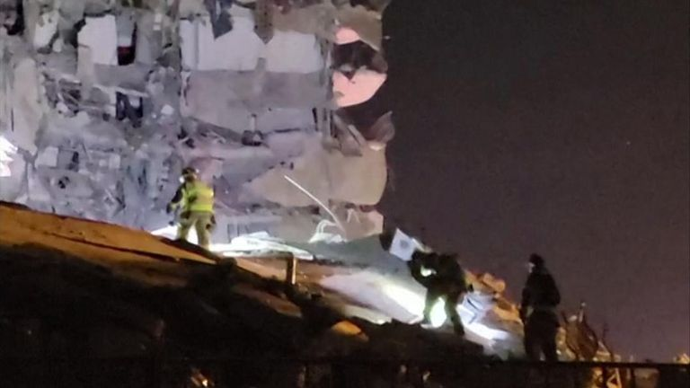 Emergency personnel work at the scene of a partial building collapse in Miami.