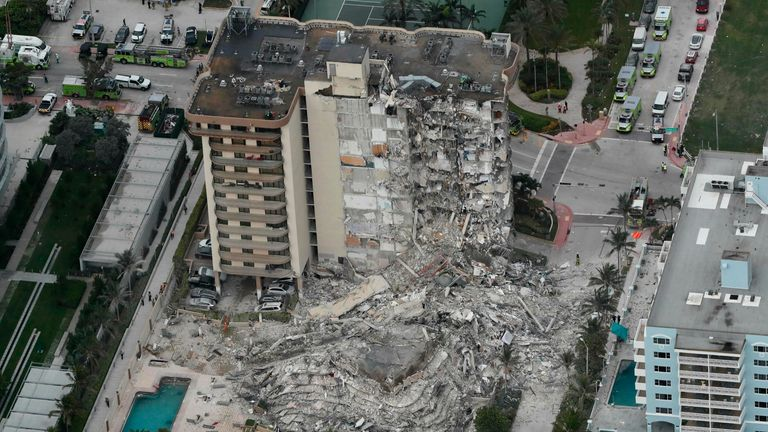 35 people were pulled from the building that partially collapsed, killing at least one person, Miami authorities said. Pic: AP